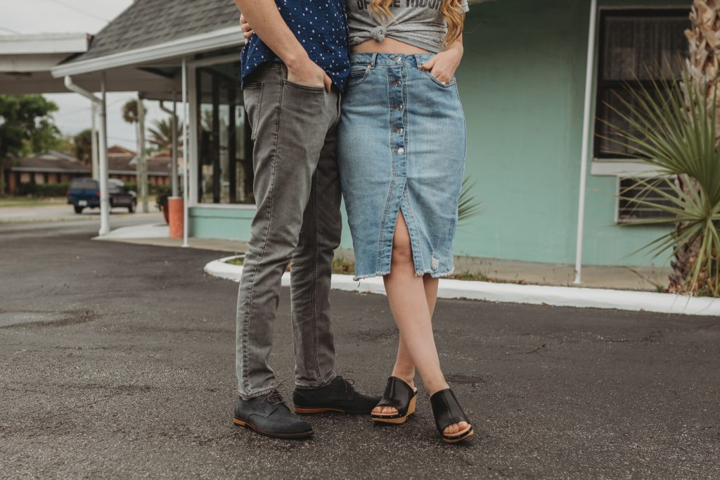 Shannon Jenkins of Upbeat Soles styles his and hers spring outfits with a retro band tee, denim button up skirt, Clarks wedges, and Clarks blue suede shoes