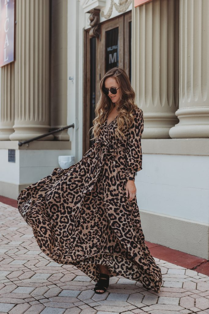 Shannon Jenkins of Upbeat Soles styles a date night outfit with Shein leopard maxi dress, Quay round sunglasses, and Kelsi Dagger sandals