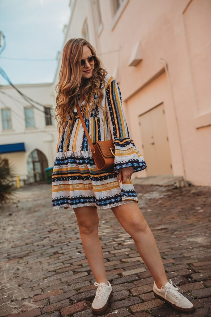Shannon Jenkins of Upbeat Soles styles a spring cute mom outfit with boho striped dress, Old Skool Vans, and round Ray Bans