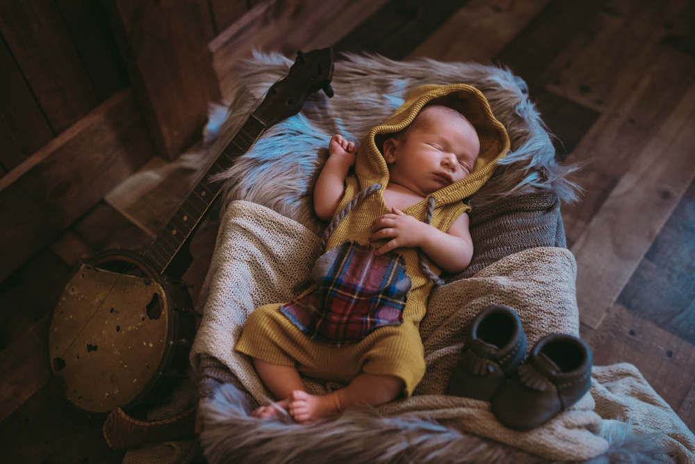 Shannon Jenkins of Upbeat Soles shares her son's newborn pictures to give newborn picture ideas and inspiration and show boy nursery decor ideas
