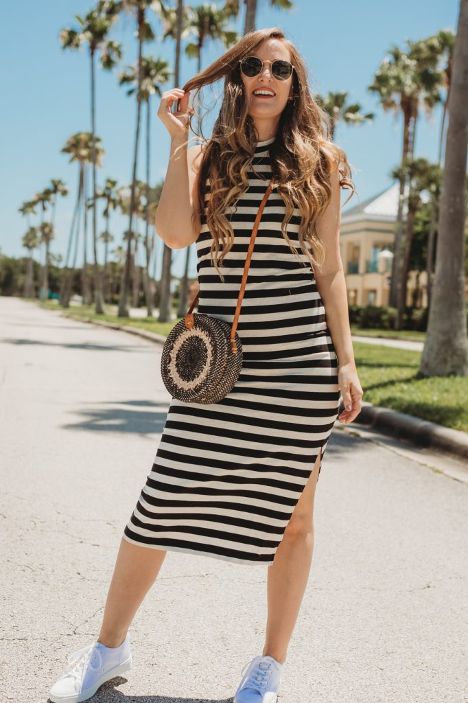 Shannon Jenkins of Upbeat Soles styles a stylish mom outfit with striped Old Navy midi dress, Sofft shoes sneakers, and round rattan bag
