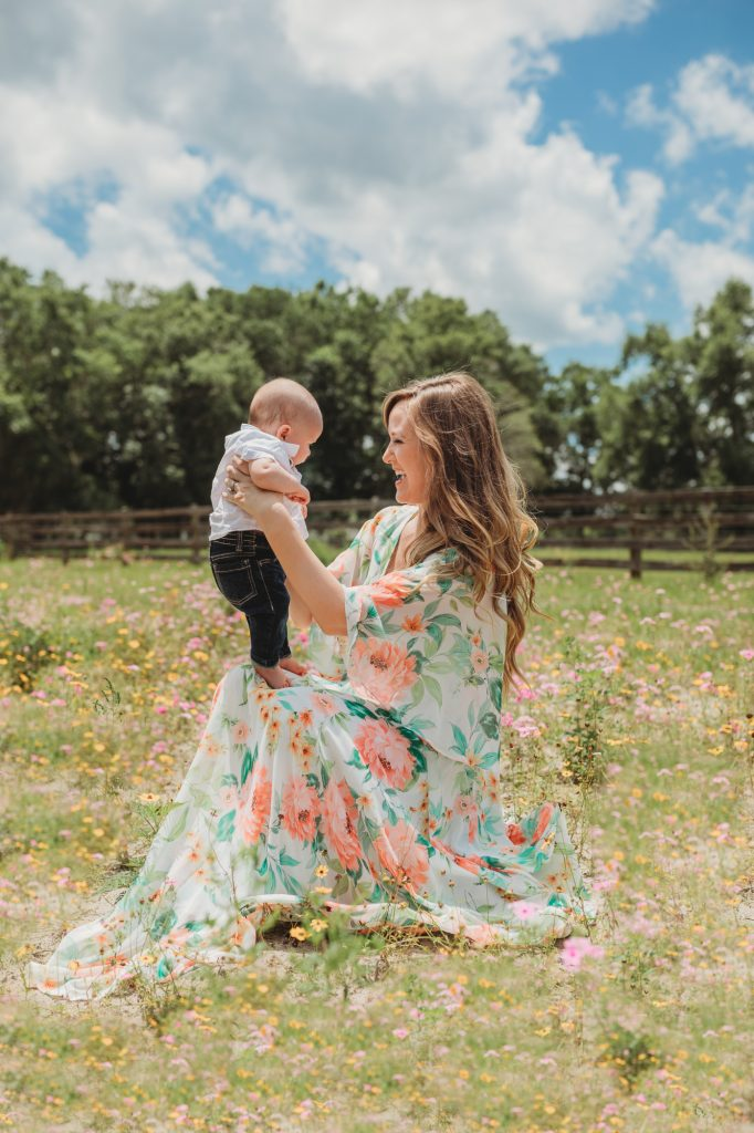 Shannon Jenkins of Upbeat Soles does a Mother's Day photoshoot with mommy and me outfits in a flower field with a Yumi Kim floral maxi dress