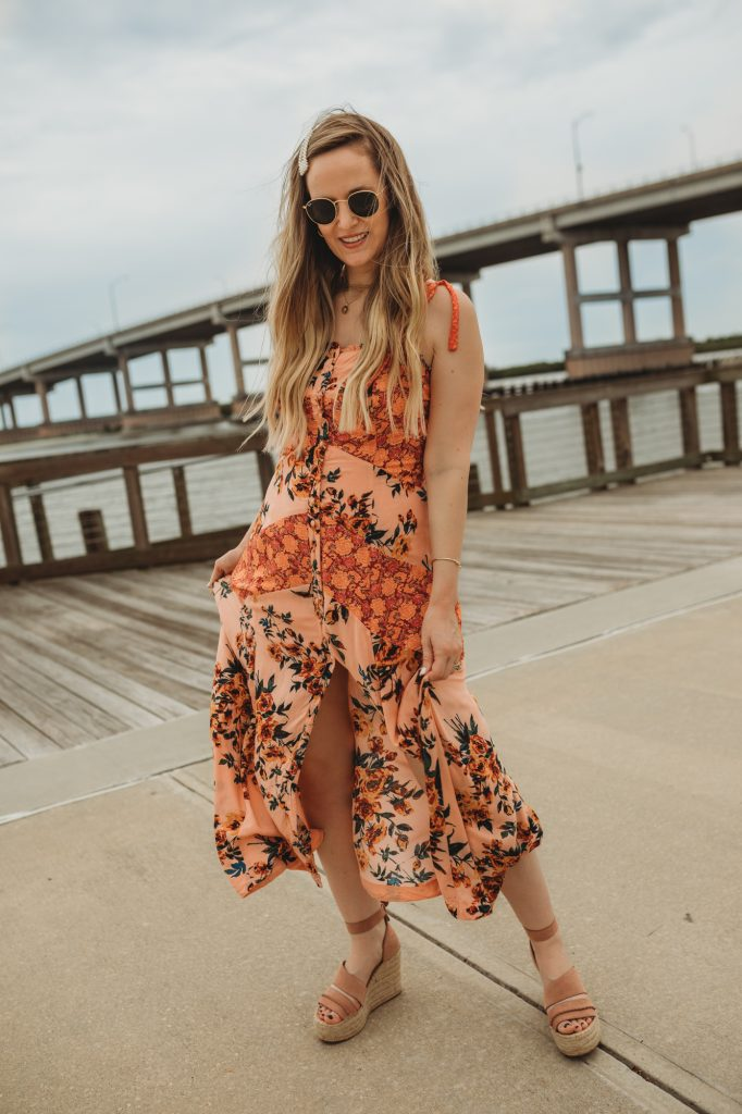 Shannon Jenkins of Upbeat Soles styles a cute summer vacation outfit with a floral maxi dress with Dolce Vita espadrille wedges and pearl Amazon hair clip