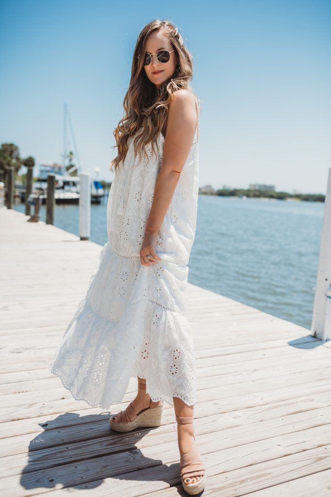 Shannon Jenkins of Upbeat Soles styles a summer vacation outfit with eyelet maxi dress from Chicwish, Dolce Vita wedges, and pearl hair clips