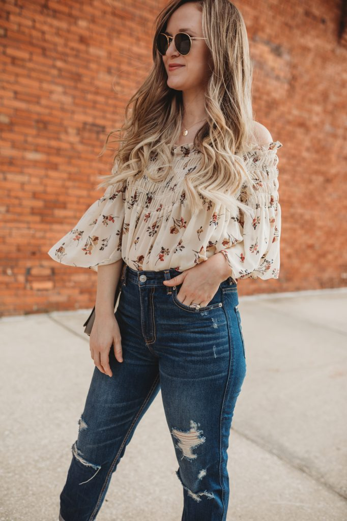Shannon Jenkins of Upbeat Soles styles a summer brunch outfit with floral off the shoulder top, Abercrombie mom jeans, and Ray Ban Icons