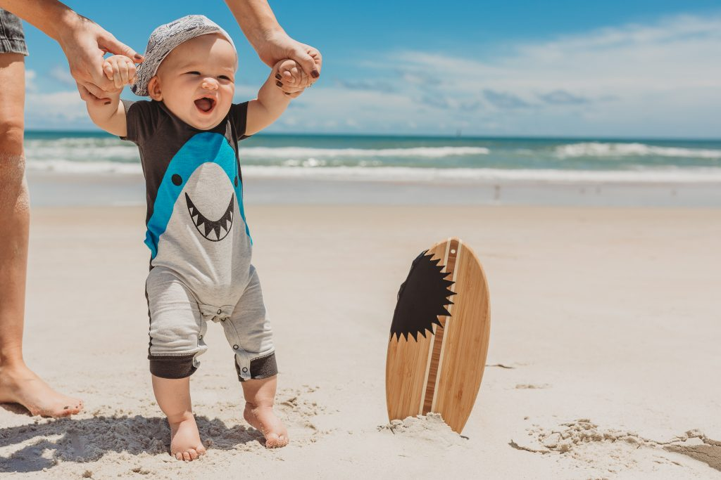 Shannon Jenkins of Upbeat Soles does a half birthday cake smash photoshoot on the beach with a shark theme for her 6 month baby boy