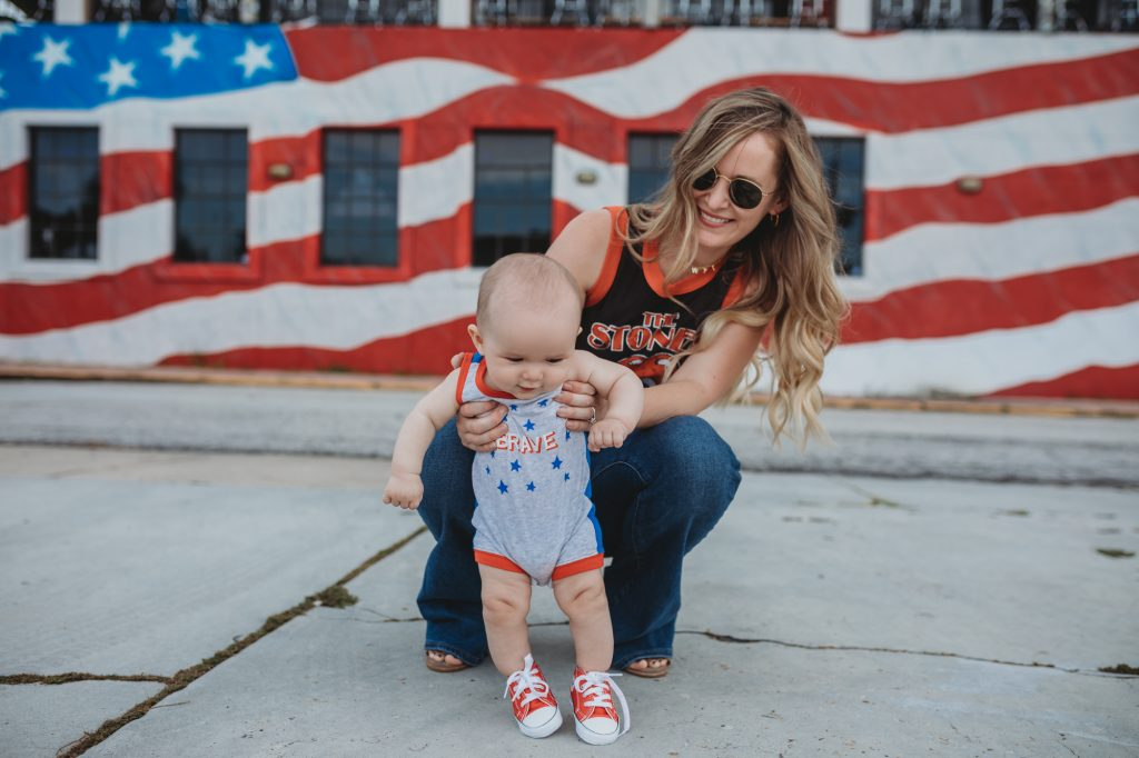 Shannon Jenkins of Upbeat Soles styles a mommy and me 4th of July outfit with target romper, baby converses, and Rolling Stones crop top