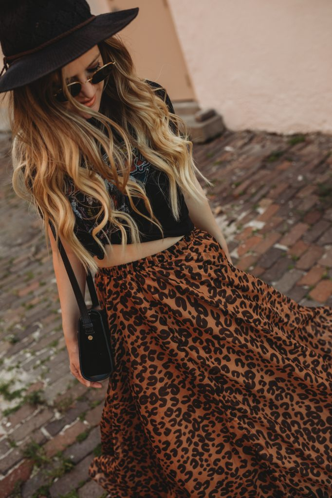 Shannon Jenkins of Upbeat Soles styles an edgy summer outfit with Chicwish leopard maxi skirt, band tee, and Sam Edelman studded sandals