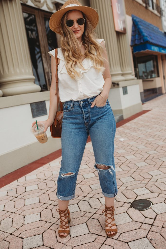 Shannon Jenkins of Upbeat Soles styles a stylish summer outfit with Old Navy ruffle top, Levi's wedgie jeans, lace up block heels and Ray Ban Icon