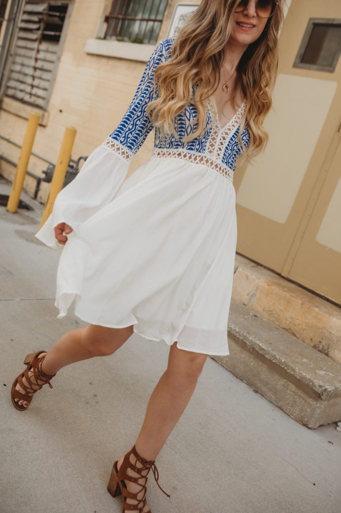 Shannon Jenkins of Upbeat Soles styles a summer boho outfit with free people dupe dress with bell sleeves, lace up sandals, and Ray Ban sunglasses