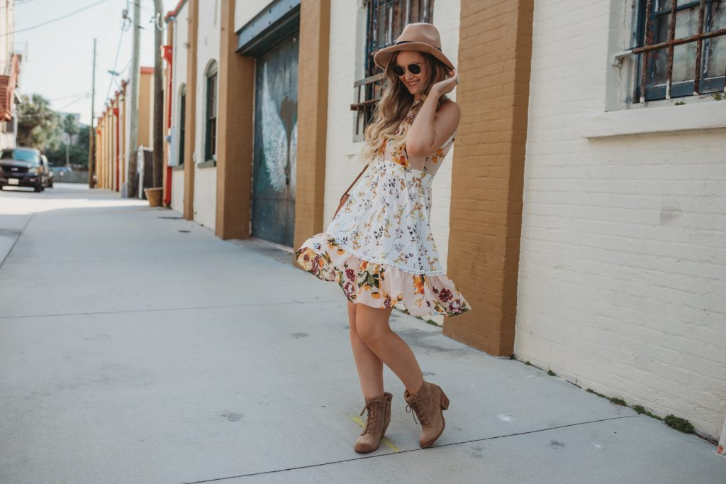 Shannon Jenkins of Upbeat Soles styles a cute fall transition outfit with Shein floral boho dress, Sofft lace up booties, and Ray Ban round sunglasses