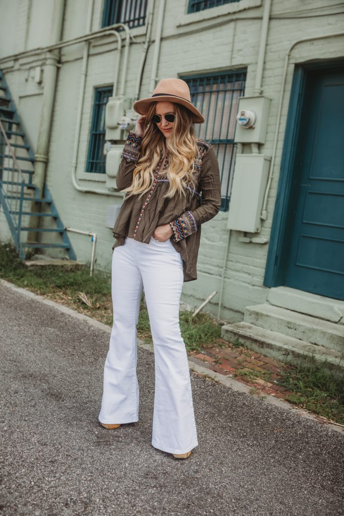 Shannon Jenkins of Upbeat Soles talkes about how to style flared jeans for fall with a boho embroidered and coin top, Lee Jeans, and round Ray Bans