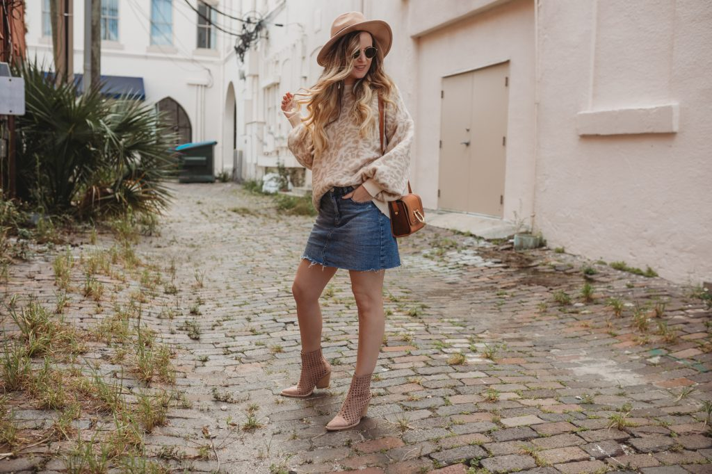 Shannon Jenkins of Upbeat Soles styles a fall leopard outfit with a denim mini skirt from Target, suede woven booties, and felt hat