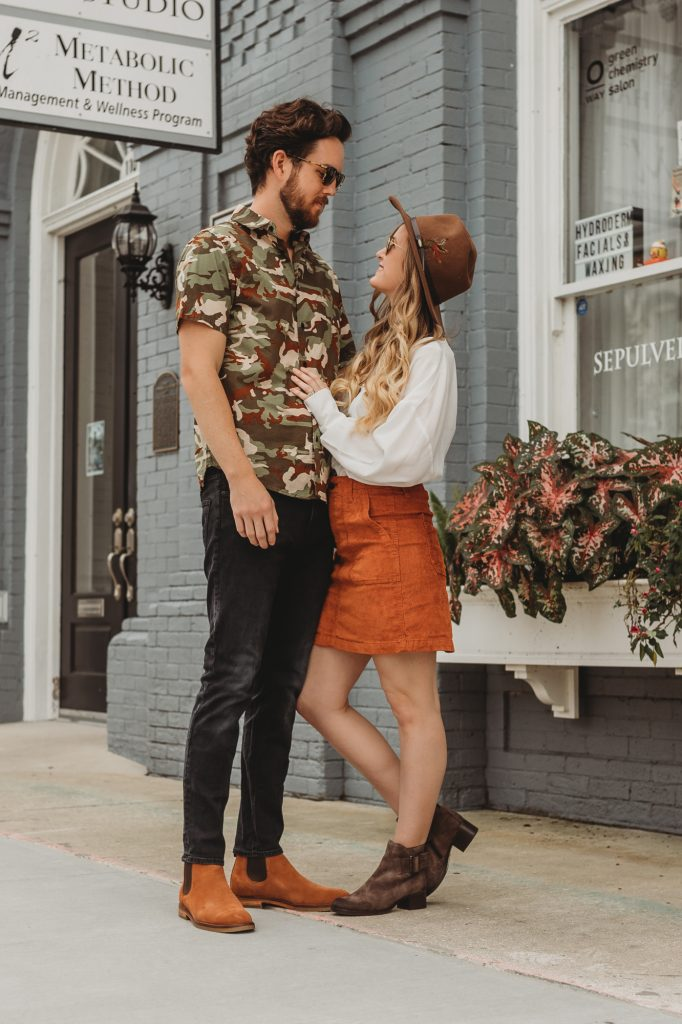 Shannon Jenkins of Upbeat Soles styles his and her fall outfits with Clarks suede booties, suede chelsea boots, corduroy skirt, and camo shirt