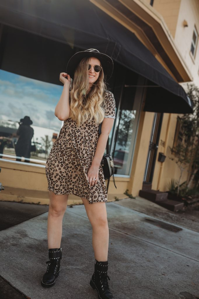 Shannon Jenkins of Upbeat Soles styles an edgy fall transition outfit with leopard Target dress, Sam Edelman combat boots and Ray Ban Icons