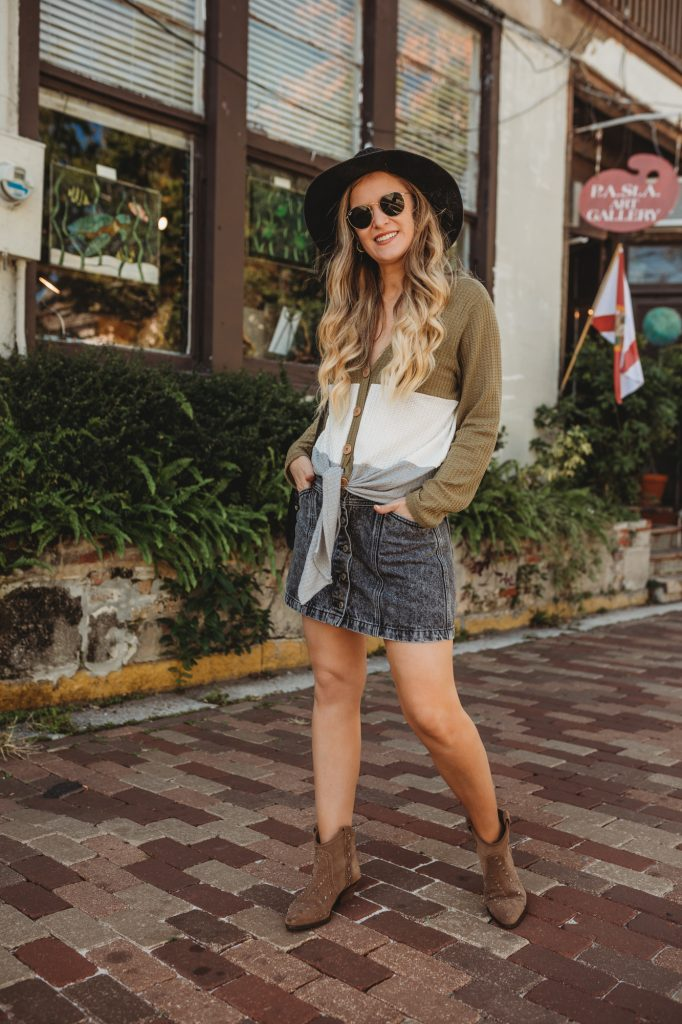 Shannon Jenkins of Upbeat Soles styles a cute casual fall outfit with a color block tie henley, button up denim skirt, and Sam Edelman western booties