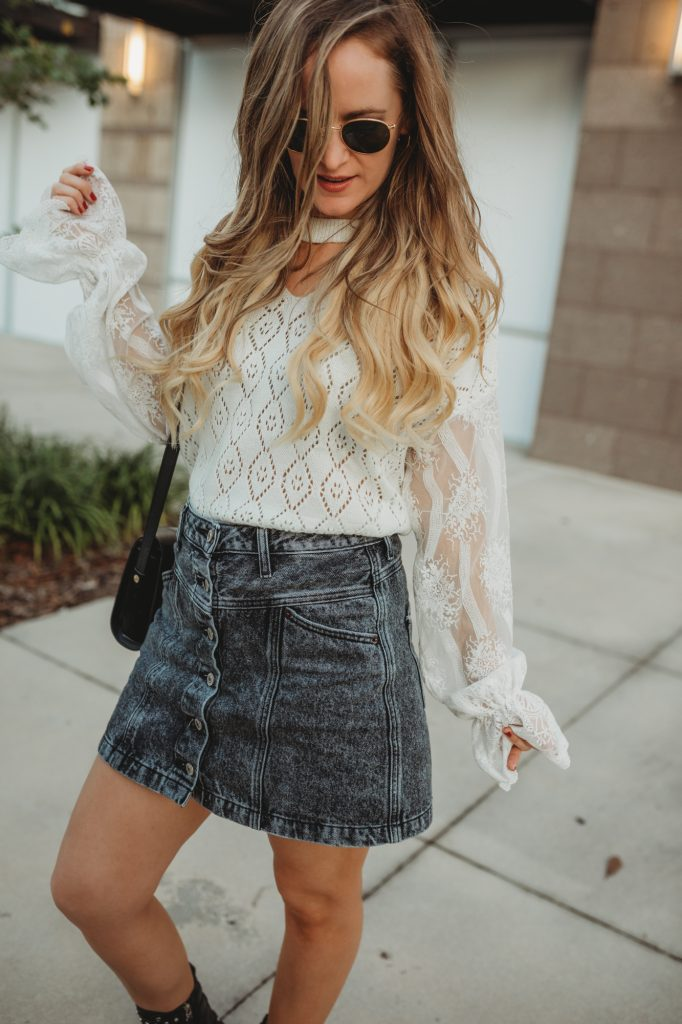 Shannon Jenkins of Upbeat Soles styles an edgy fall outfit with Chicwish lace sleeve sweater, Abercrombie denim skirt and studded combat boots