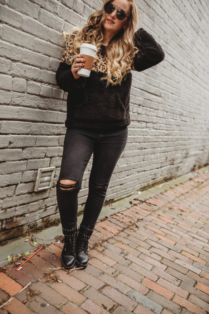 Shannon Jenkins of Upbeat Soles styles a casual winter outfit with cozy sherpa leopard sweater, Target distressed jeans, and San Edelman combat boots