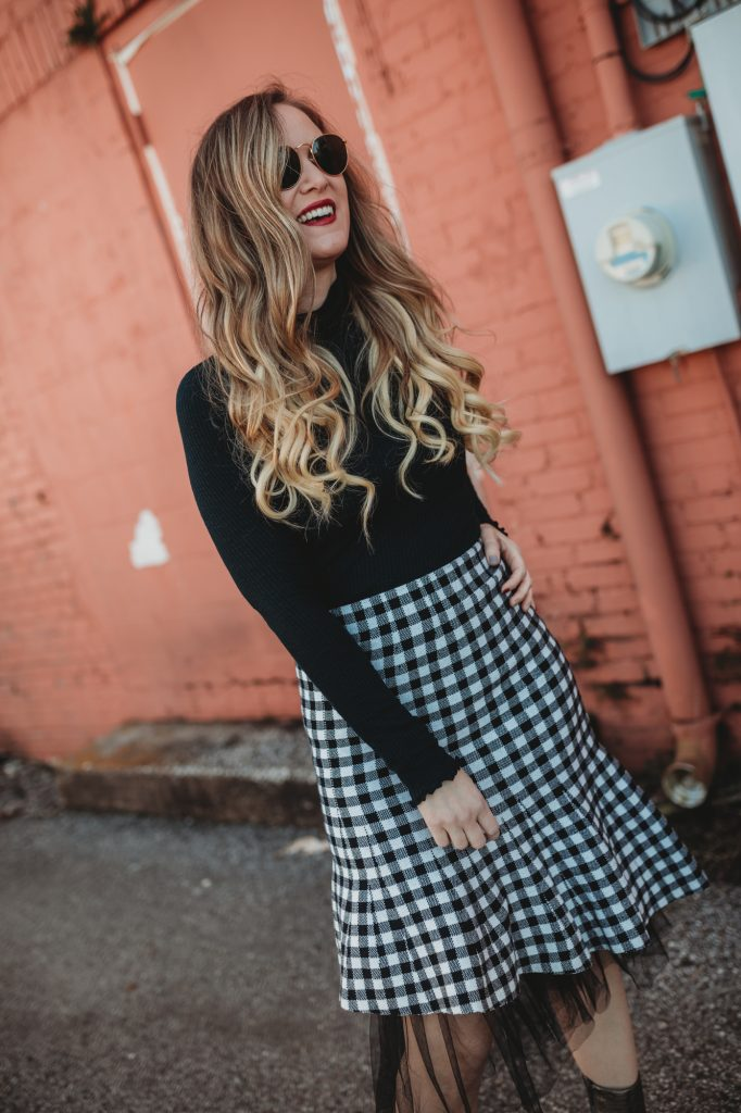 Shannon Jenkins of Upbeat Soles styles a cute holiday outfit with mock neck turtle neck, Chicwish gingham skirt and metallic booties
