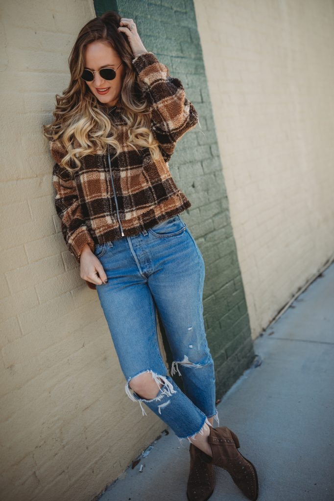 Shannon Jenkins of Upbeat Soles styles a causal winter outfit with plaid teddy jacket, Levi's 501 jeans, and Sam Edelman booties