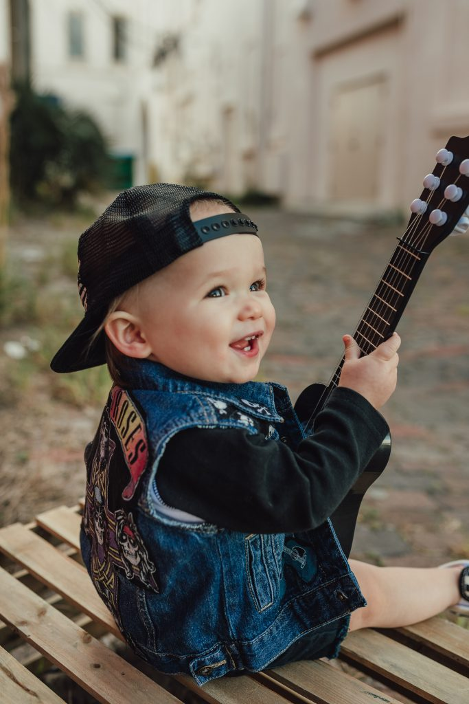Shannon Jenkins of Upbeat Soles shoes her son's boy first birthday pictures and cake smash that is rock and roll theme with little guitar