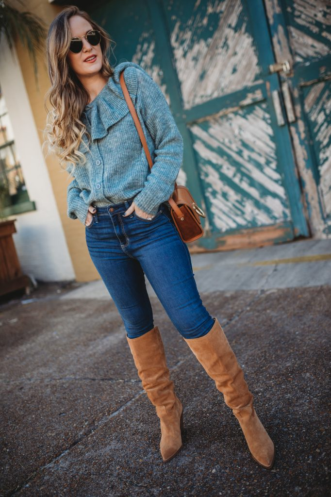 Shannon Jenkins of Upbeat Soles styles a casual winter outfit with Chicwish ruffled sweater, high waisted Hollister jeans, and Sam Edelman suede boots