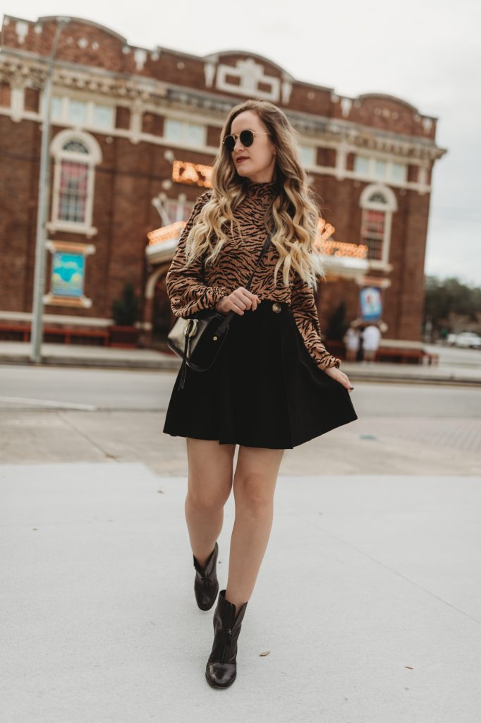 Shannon Jenkins of Upbeat Soles styles a winter date night outfit with Target animal print top, Chicwish skater skirt, and black ankle booties