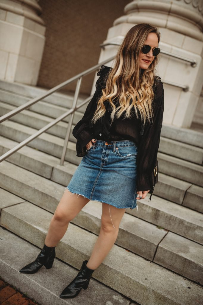 Shannon Jenkins of Upbeat Soles styles a casual date night outfit with sheer black Chicwish top, Blank NYC skirt, and Marc Fisher booties