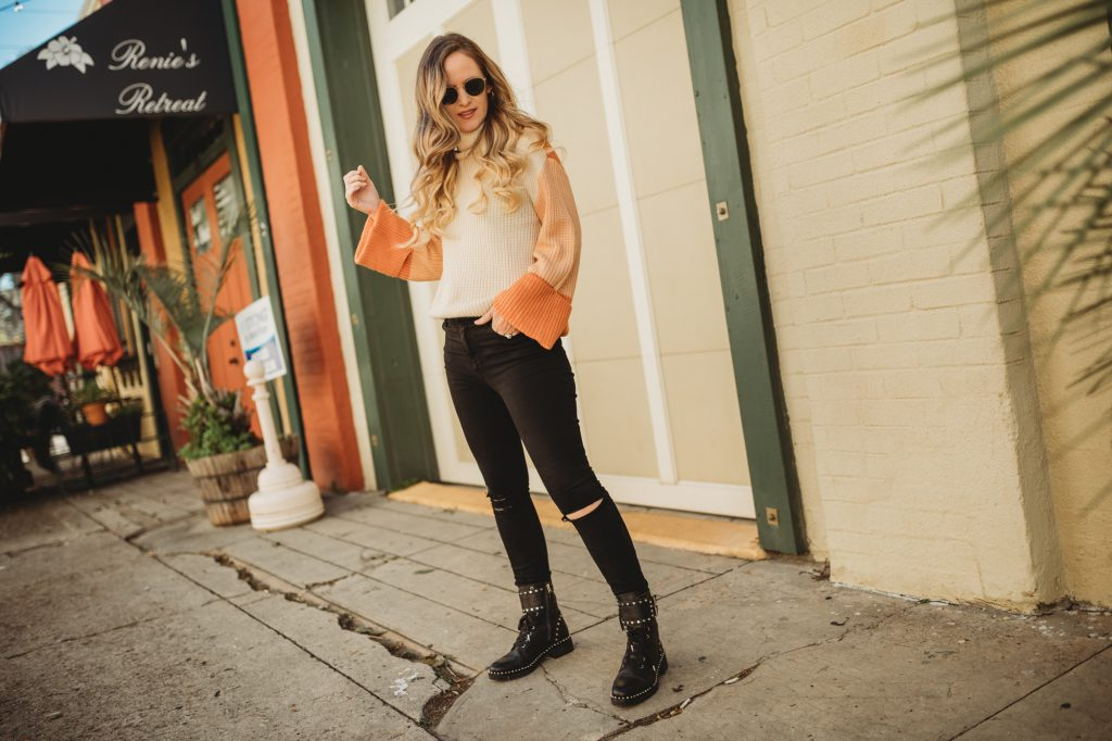 Shannon Jenkins of Upbeat Soles styles an edgy winter outfit with color block bell sleeve sweater, Abercrombie black jeans, and Sam Edelman combat boots