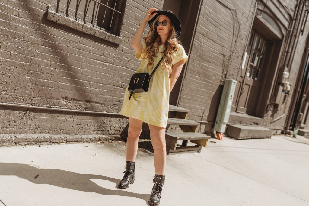 Shannon Jenkins of Upbeat Soles styles a spring transition outfit with Target tie dye dress, Sam Edelman combat boots, and black hat