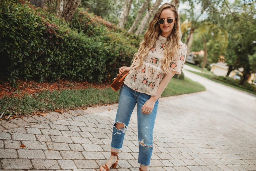 Shhannon Jenkins of Upbeat Soles styles a cute casual spring outfit with Chicwish floral eyelet peplum top, Levi's 501 jeans and suede lace up sandals