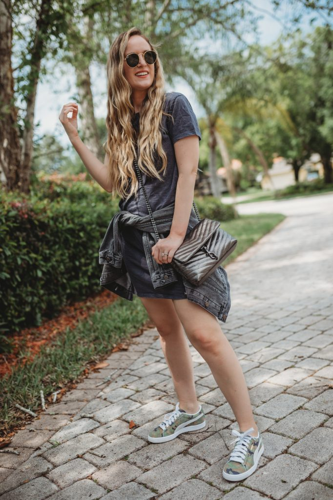 Shannon Jenkins of Upbeat Soles styles a dress and sneakers outfit with Target shirt dress, camo Puma sneakers, and Rebecca Minkoff purse