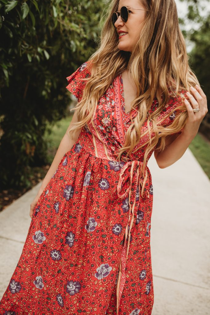 Shannon Jenkins of Upbeat Soles styles a summer boho floral maxi dress from Chicwish with Vince Camuto studded sandals and Ray Ban Icons