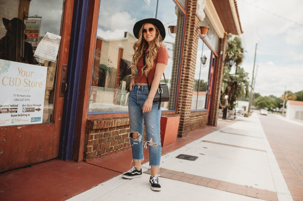 Shannon Jenkins of Upbeat Soles shows how to style mom jeans with Levi Wedgie jeans, Abercrombie collared short, and Old Skool Vans
