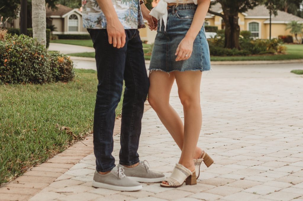 Shannon Jenkins of Upbeat Soles styles a his and her summer outfit with tie crop top, denim skirt, Rockport sandals, and Abercombie mens shirt