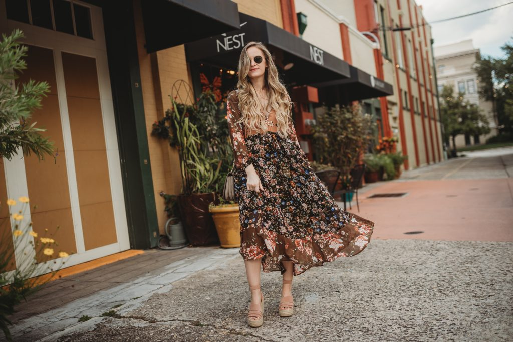 Shannon Jenkins of Upbeat Soles styles a summer boho outfit with Chicwish dark floral maxi dress with Dolce Vita wedges, and Ray Ban Icon sunglasses