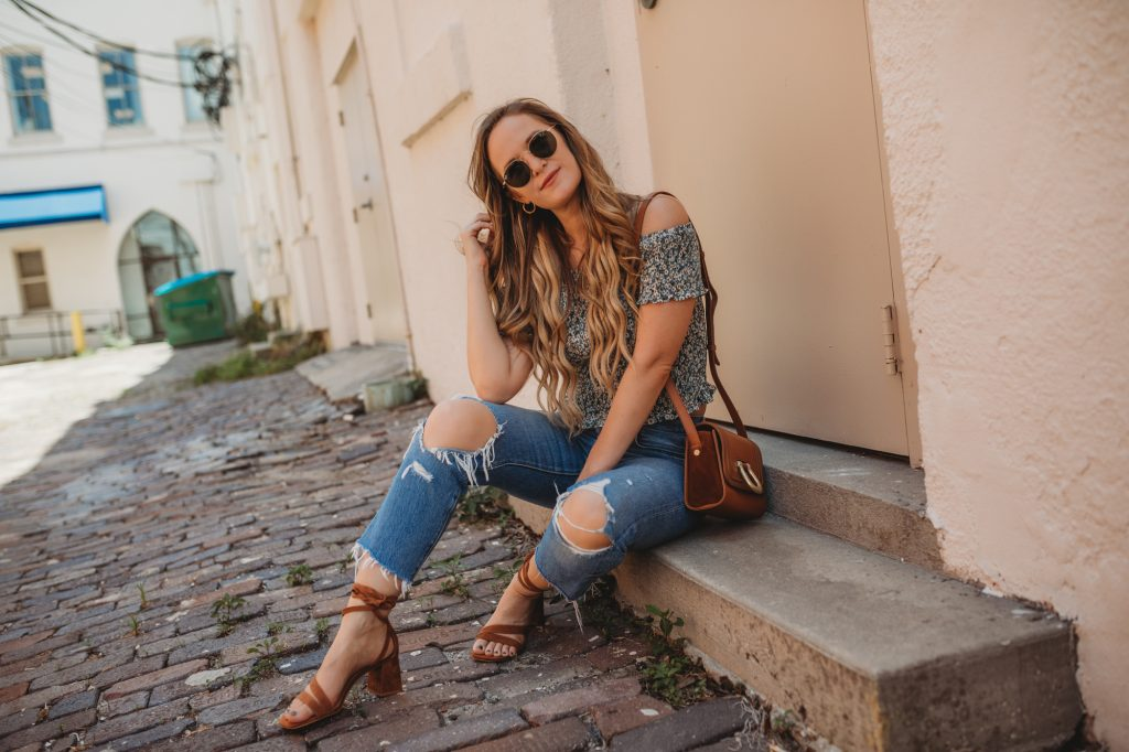 Shannon Jenkins of Upbeat Soles styles a cute summer brunch outfit with floral Chicwish crop top, Levi's 501 jeans, and suede lace up sandals