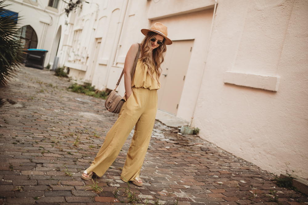 Shannon Jenkins of Upbeat Soles styles a cute summer jumpsuit with yellow two piece from Chicwish, metallic espadrilles, and See by Chloe bag