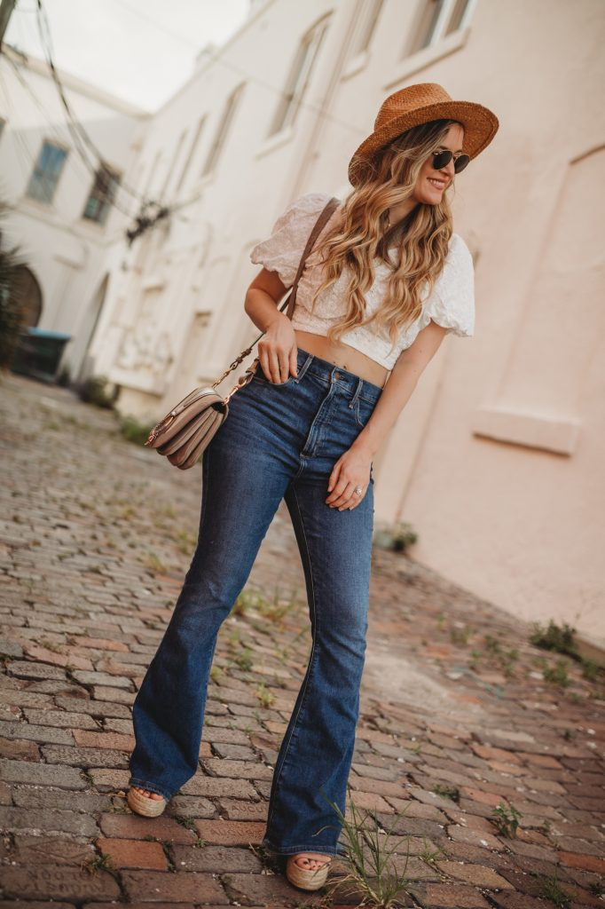 Shannon Jenkins of Upbeat Soles talks about how to style a crop top and flared jeans with Dolce Vita wedges, See by Chloe crossbody, and Ray Ban Icons