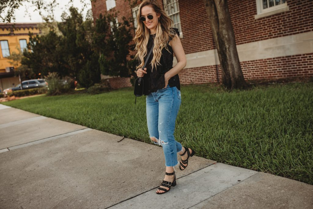 Shannon Jenkins of Upbeat Soles styles a cute casual summer outfit with black eyelet Chicwish top, Levi's 501 jeans, and Vince Camuto sandals