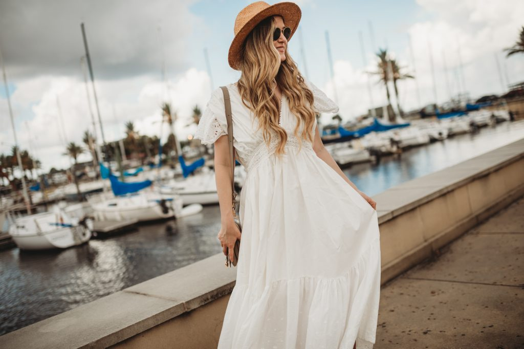 Shannon Jenkins of Upbeat Soles styles a white summer maxi dress from chicwish that has eyelet flutter sleeves and lace hemline with espadrille sandals