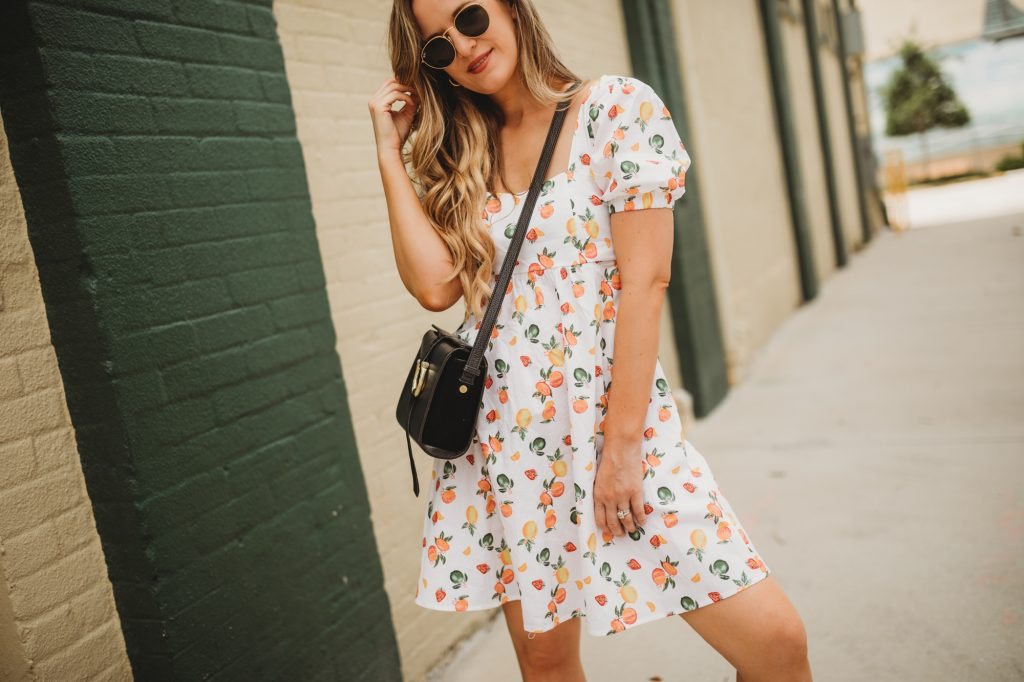 Shannon Jenkins of Upbeat Soles styles a sporty casual summer outfit with Target fruit print dress, Old Skool Vans, and round Ray Ban sunglasses