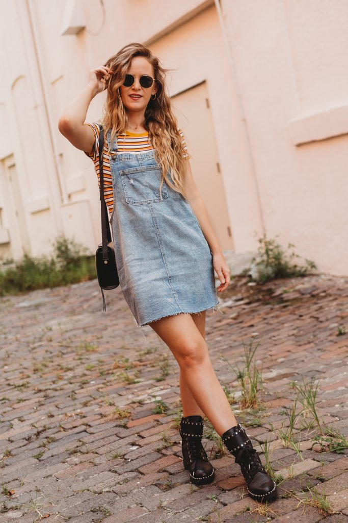 Shannon Jenkins of Upbeat Soles talks about how to style overalls with striped crop top, black combat boots for a 90's inspired outfit