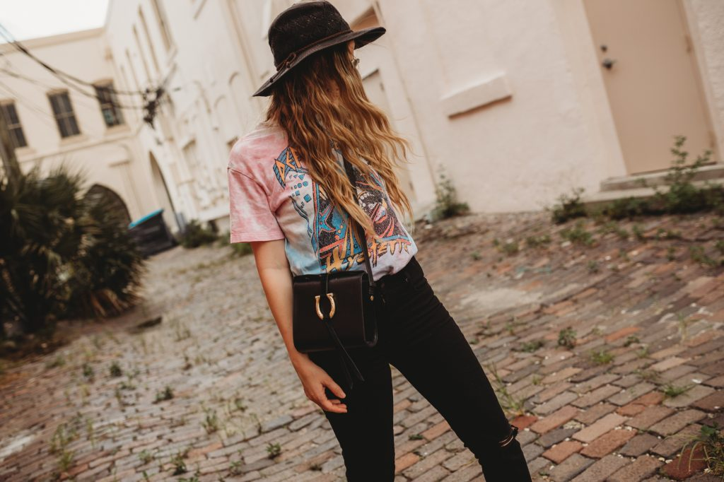 Shannon Jenkins of Upbeat Soles talks about how to style a band tee with black Levi's jeans, Vans checkered slip ons, and black hat