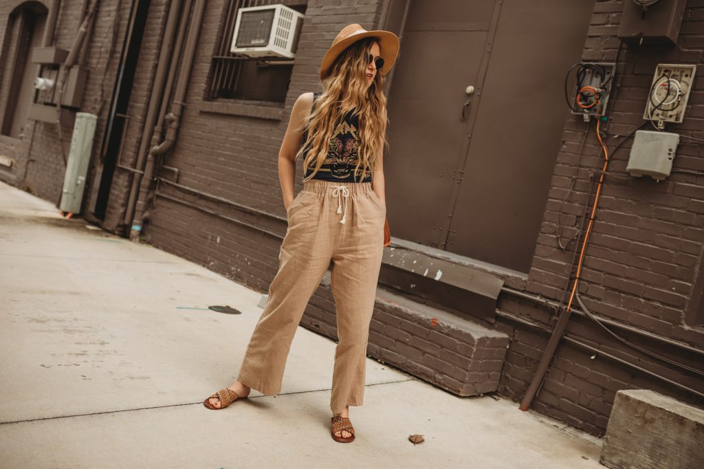 Shannon Jenkins of Upbeat Soles styles a laid back summer outfit with Chaser band tee, Chicwish beach pants, and Sancia bag