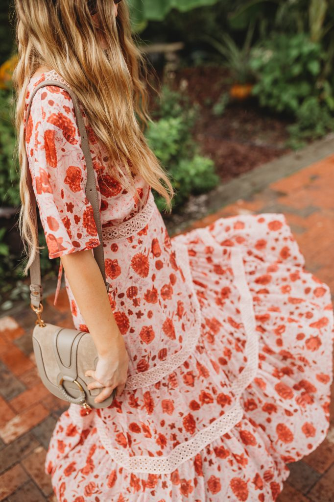 Shannon Jenkins of Upbeat Soles styles a red and pink maxi dress from Chicwish with metallic Shopbop espadrille sandals, and See by Chloe bag