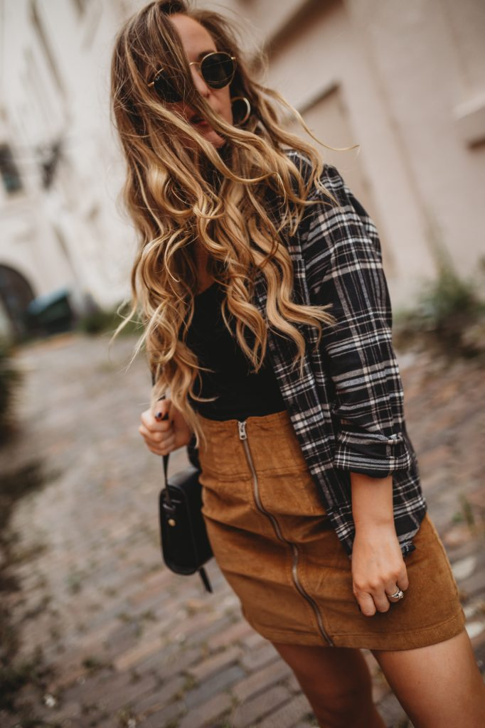 Shannon Jenkins of Upbeat Soles styles a grunge fall outfit with Target fall flannel, corduroy skirt, and Dr Martens boots