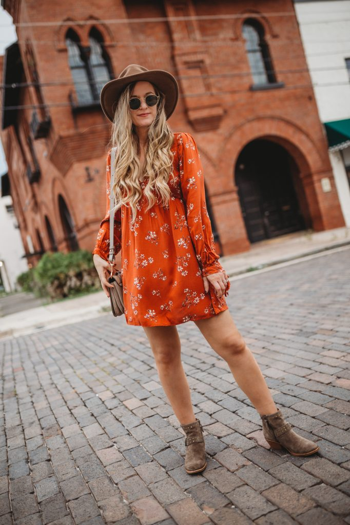 Shannon Jenkins of Upbeat Soles styles a boho fall transition outfit with orange Target dress, suede studded booties, and See by Chloe bag