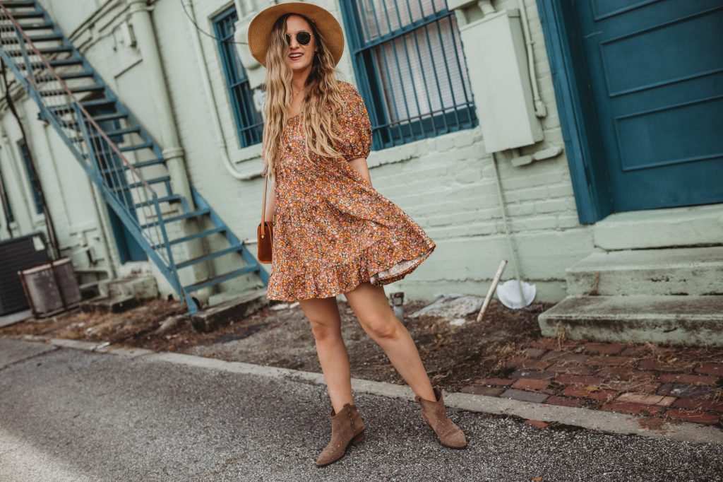 Shannon Jenkins of Upbeat Soles styles a boho fall transition out with with Target Wild Fable dress, Sam Edelman booties, and Ray Ban glasses