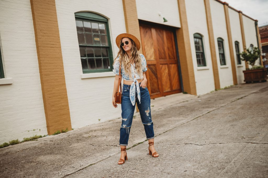 Shannon Jenkins of Upbeat Soles styles a cute weekend outfit with an eyelet floral crop top, Abercrombie mom jeans, and lace up sandals
